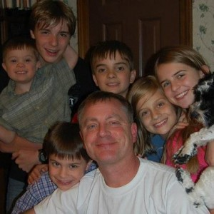 Kevin, the father of James, with 6 of his children. Can you look at these happy faces and not have faith?